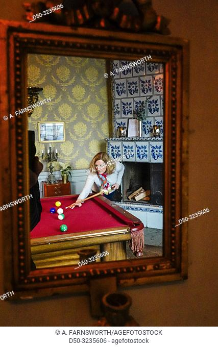 Stockholm, Sweden A woman plays pool at Häringe Slott or Haringe Castle, known for its decadent parties throughout the centuries