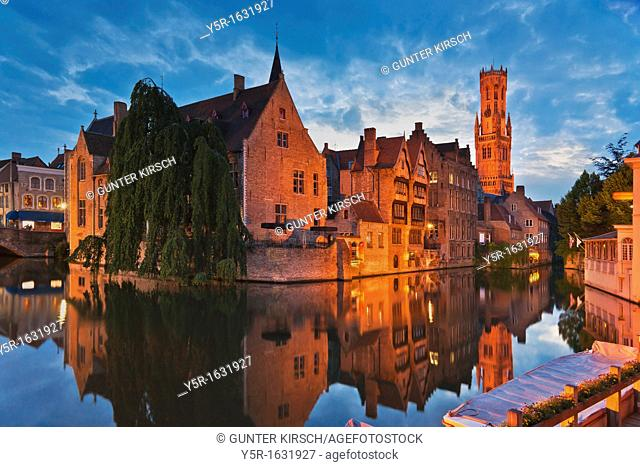 View from Rozenhoedkaai via the Reie river to Belfry, built from 1282 to 1482 The tower is 88 meters high The carillon consists of 47 bells, Bruges, Belgium