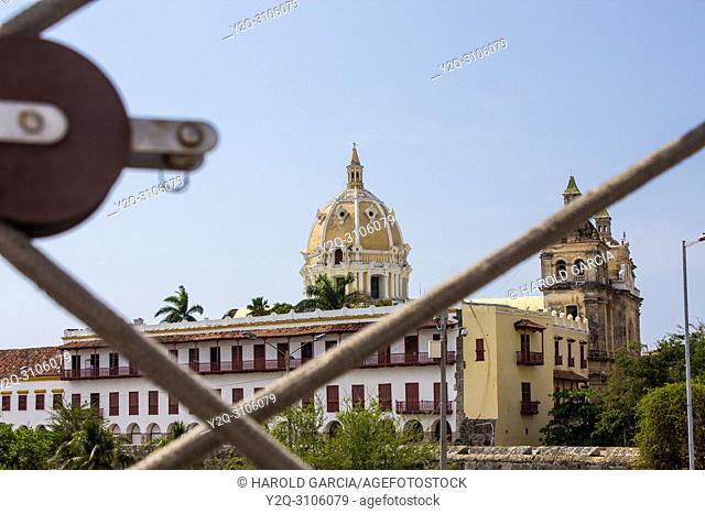 In focus close up of a vessel rope and blurry Dome of the Cathedral Basilica of St. Catherine of Alexandria in the ancient walled city of Cartagena de Indias
