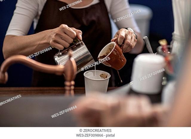 Barista preparing iced coffee