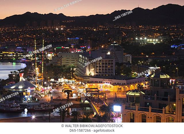 Israel, The Negev, Eilat, Red Sea beachfront, elevated resort view, evening