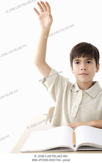 Young student raising his hand