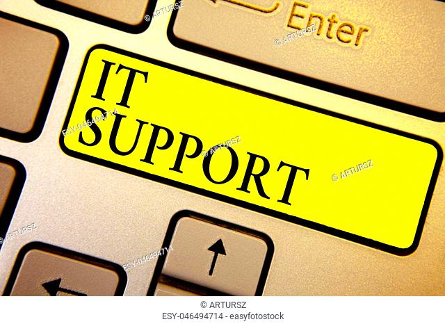 Handwriting text It Support. Concept meaning Lending help about information technologies and relative issues Keyboard yellow key Intention create computer...