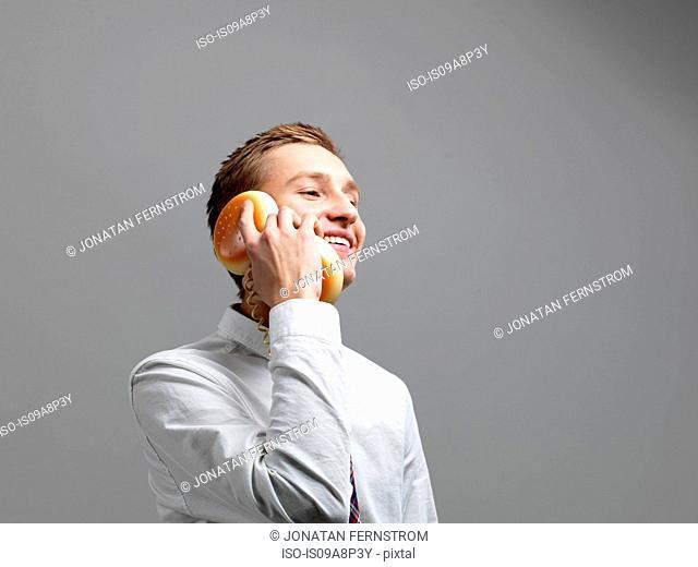Man using hamburger telephone