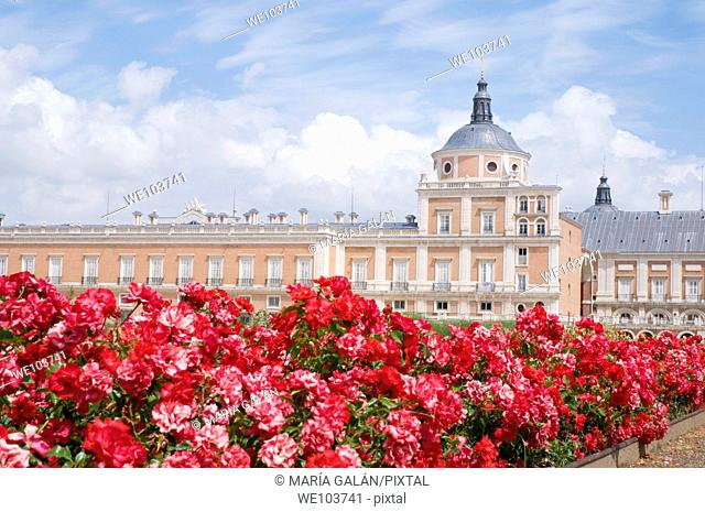 Royal Palace and red flowers. Aranjuez, Madrid province, Spain