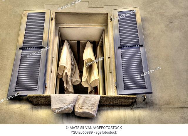 Old open window with shutter and clothes, Ascona, Switzerland