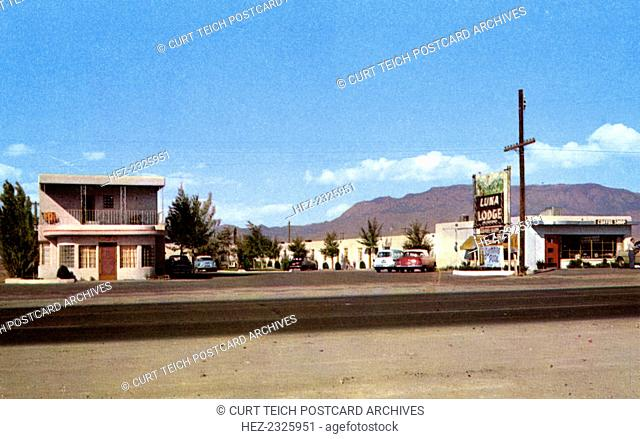 Luna Lodge, Albuquerque, New Mexico, USA, 1943. Vintage postcard view of the Luna Lodge on Route 66. Vintage cards are parked beside the motel and mountains are...