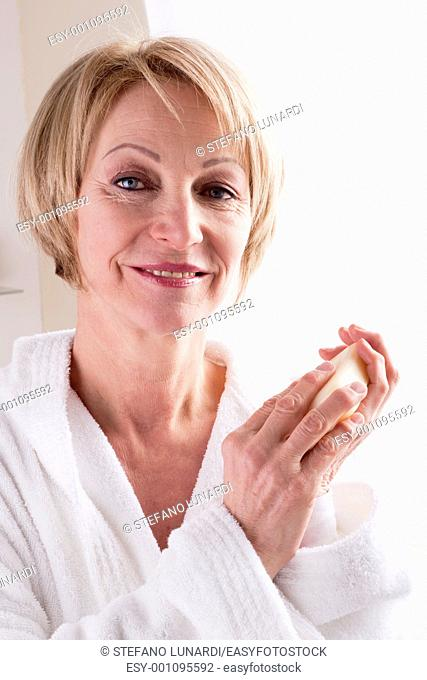 Mature Woman Holding Soap