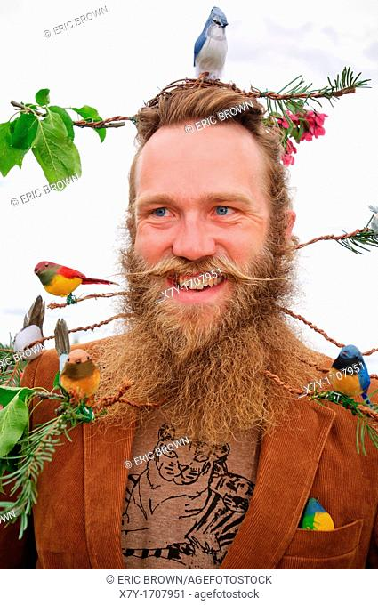 Competitor with beard styled as a tree with birds, at the 2010 USA National Beard and Moustache Championships in Bend, OR, USA  June 5, 2010