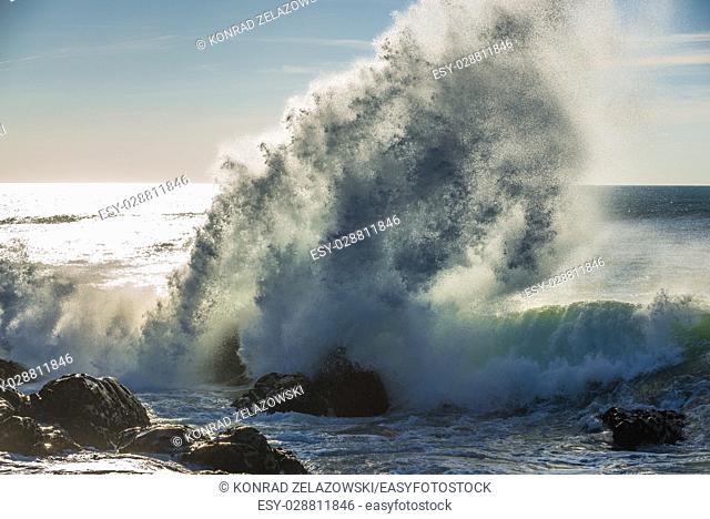 Spectacular wave crashing into rocks of Atlantic Ocean shore in Nevogilde civil parish of Porto, second largest city in Portugal