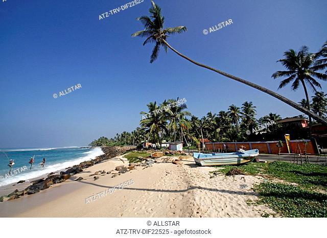 STILT FISHERMEN & INDIAN OCEAN; MIDIGAMA, SRI LANKA; 19/03/2013