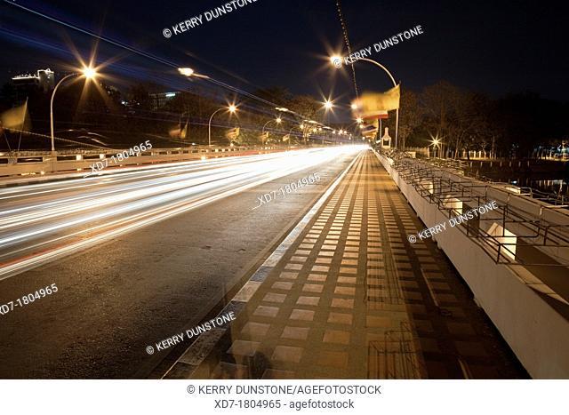 Traffic crossing Saphan Nawarat Bridge at night, Chiang Mai, Thailand