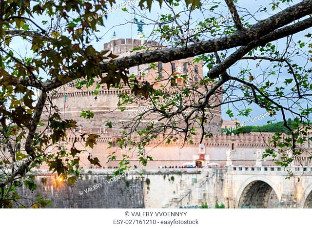 travel to Italy - branch of sycamore tree and Castel Sant Angelo (Castle of the Holy Angel) on background in Rome city in autumn evening twilight