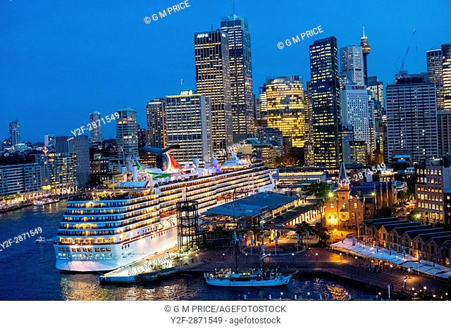 Sydney city skyline and berthed cruise ship