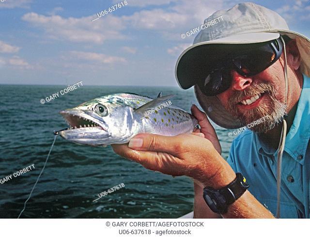 Florida fisherman holding a Spanish mackerel in Charlotte harbor