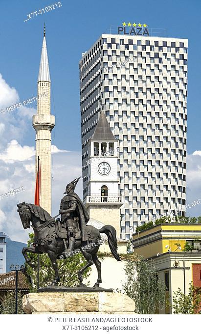 Four of Tirana's landmarks - The Statue of Skanderbeg, The Et'hem Bey Mosque, the clock tower and the Plaza Hotel seen from Skanderbeg Square Tirana, Albania