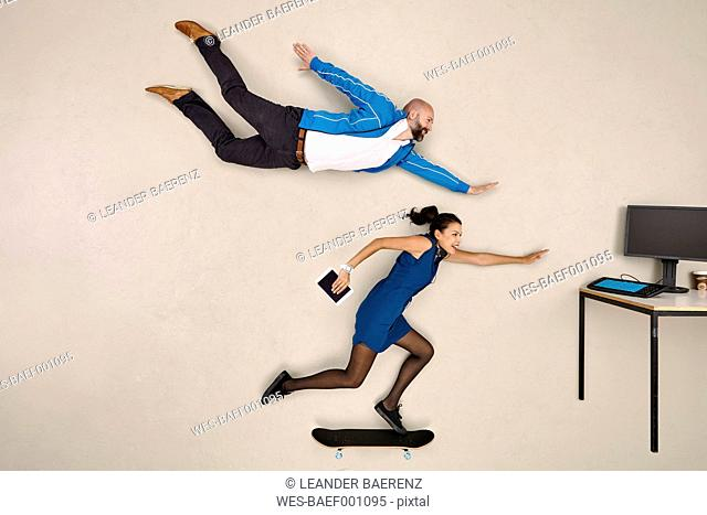 Modern business colleagues flying and skateboarding towards office desk