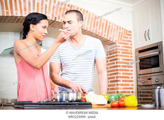 Smiling couple preparing vegetables