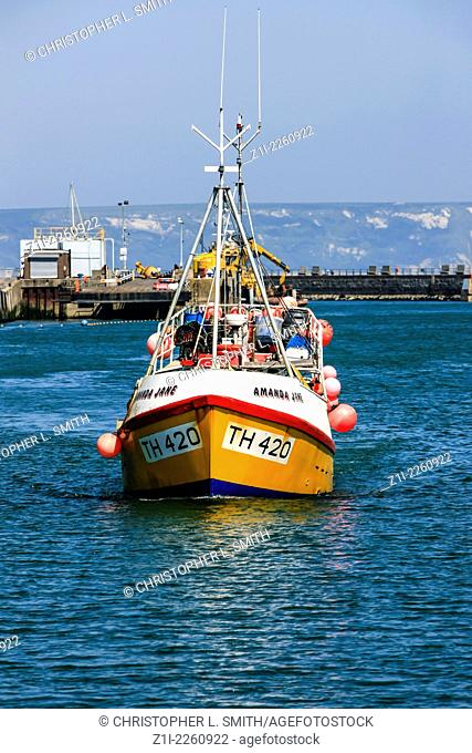 Fishing Boat sails into Weymouth harbour to unload it's catch of crabs