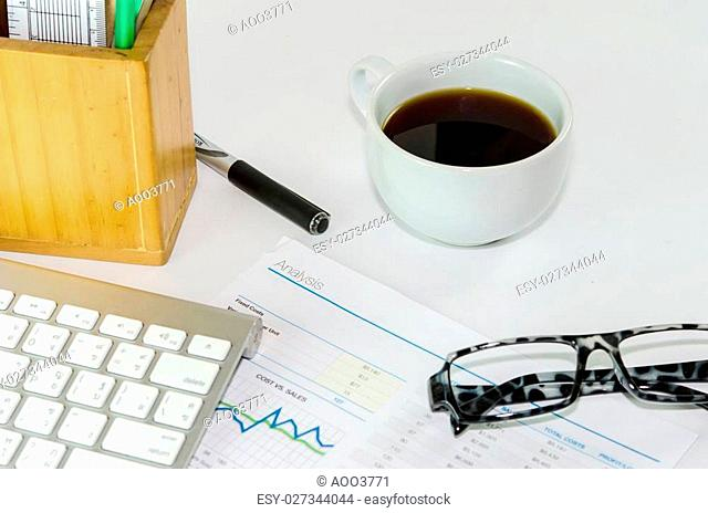 Business documents and coffee on the desk