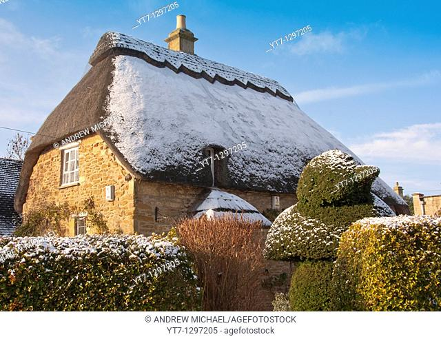 A thatched cottage covered in snow on the edge of the Cotswold village of Chipping Campden  England