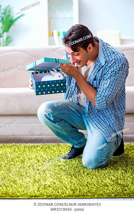 Young man getting rabbit as birthday present