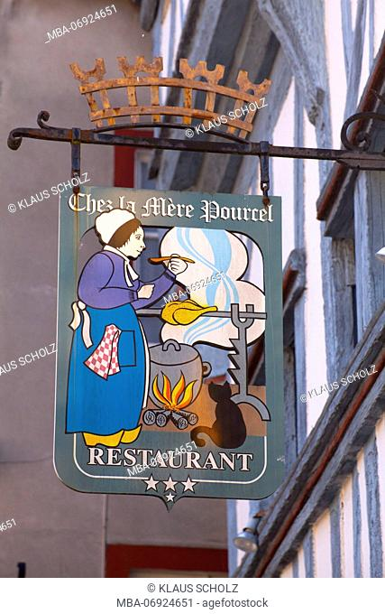 Restaurant sign in the old town of Dinan