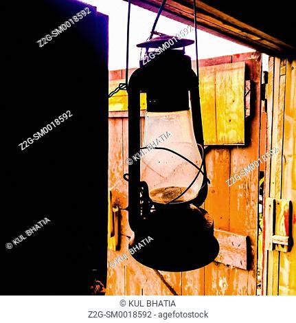 An old-fashioned lantern hangs in a doorway, Halifax, Canada