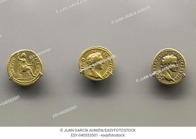 Three golden coins of Tiberius Emperor. Isolated over grey