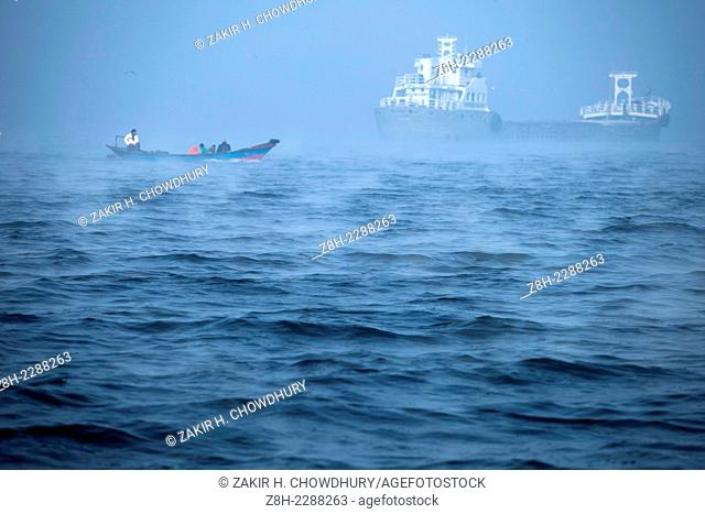 Boat and cargo ship on the river meghna in winter morning