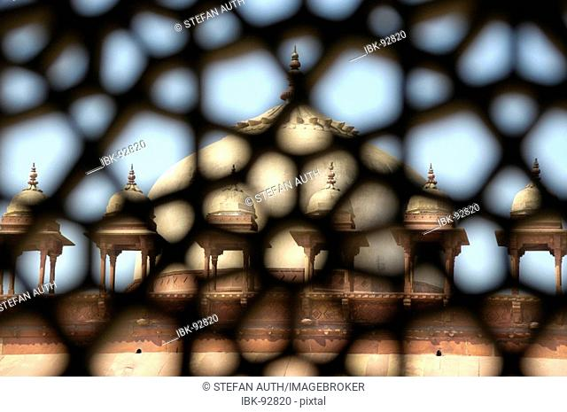 View through a fine ornamented window on a dome with small towers Akbar Mosque Fatehpur Sikri Uttar Pradesh India