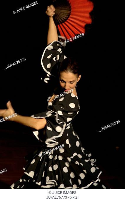 View of a young woman flamenco dancing