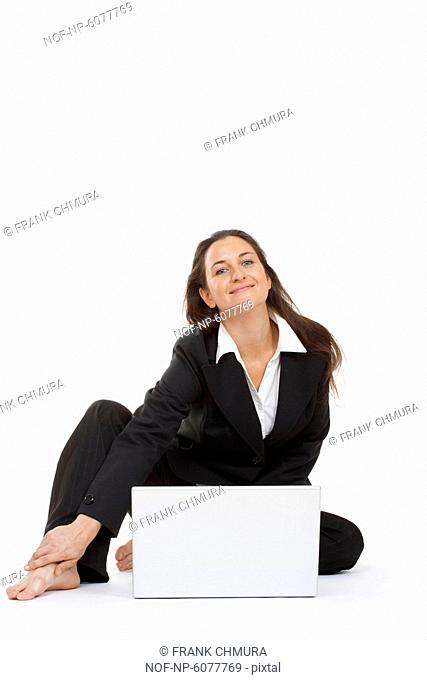 A businesswoman working with laptop computer smiling