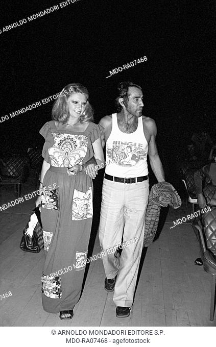 Italian actor, comedian and TV host Walter Chiari (Walter Annichiarico) arm in arm with Italian actress Sylva Koscina (Silva Košćina)