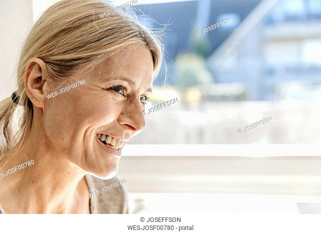 Portrait of smiling woman at home