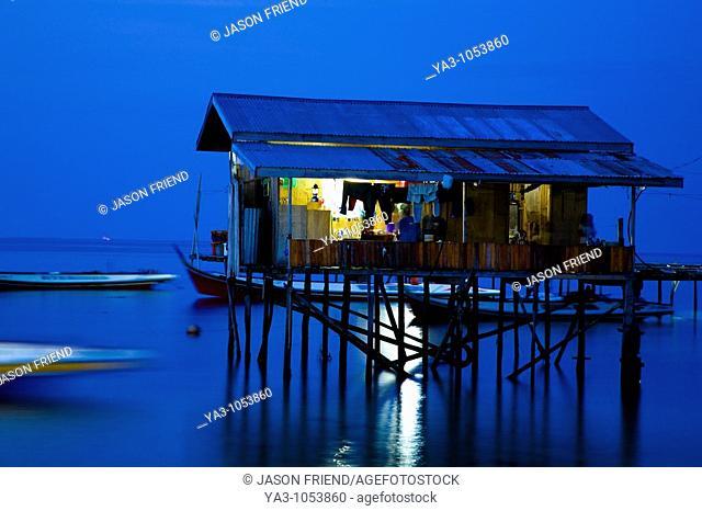 Sabah Malaysia, Borneo, Mabul Island  Water village on Mabul Island near Sipadan, viewed at dusk