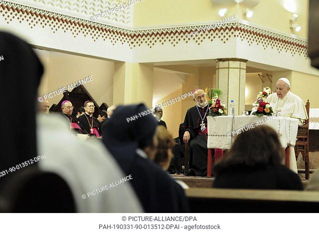 31 March 2019, Morocco, Rabat: Pope Francis (R) and Archbishop of Rabat Cristobal Lopez Romero (2-R) attend a meeting with priests and Christian representatives...