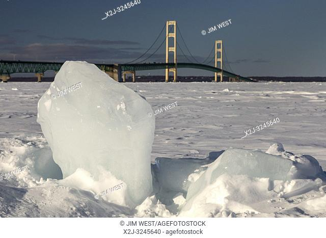 Mackinaw City, Michigan - The Mackinac Bridge across the frozen Straits of Mackinac. The straits connect Lake Michigan and Lake Huron