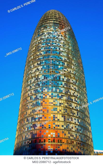 BARCELONA, SPAIN : Torre Agbar in the Poblenou neighborhood in Barcelona, Spain. Owned by the Agbar Group, it is a 38-story skyscraper / tower and a famous...