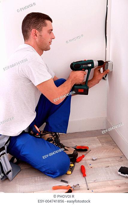 portrait of a man drilling