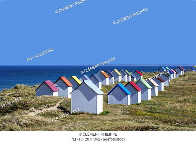 Row of colourful beach cabins in the dunes at Gouville-sur-Mer, Lower Normandy, France