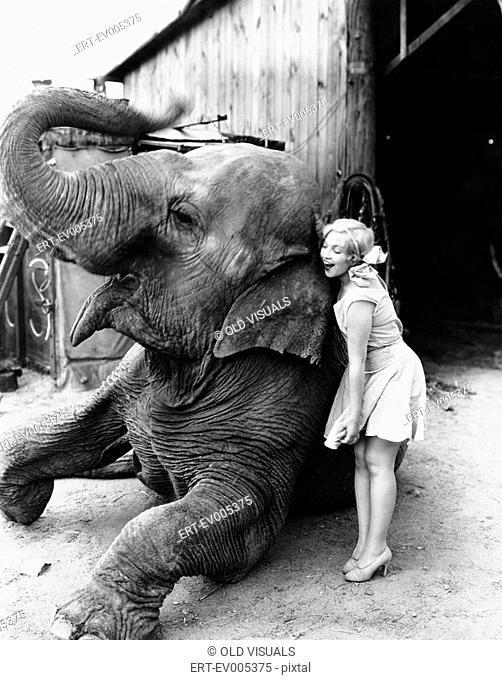 Profile of a young woman hugging an elephant All persons depicted are not longer living and no estate exists Supplier warranties that there will be no model...