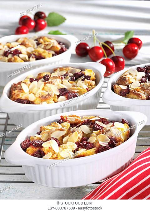 Cherry pudding with flaked almonds