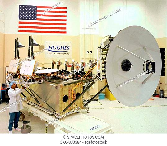 Technicians make final adjustments to the --X minus-X wing of a Milstar satellite, which contains the medium-data-rate MDR communications payload and a portion...