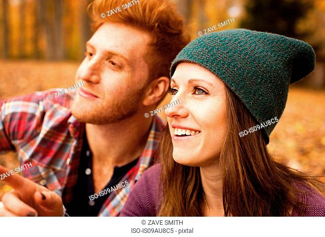 Happy young couple in autumn forest
