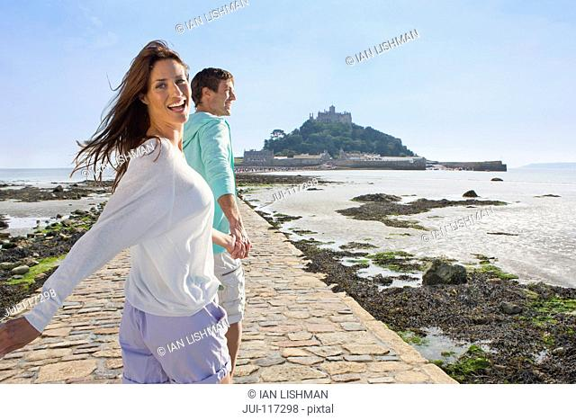 Mature Couple Visiting St Michaels Mount In Cornwall
