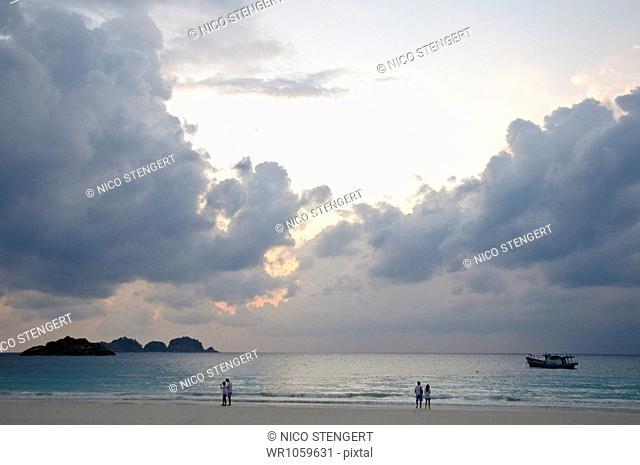 Boat at sunrise with cloud formation, Pulau Redang island, Malaysia, Southeast Asia, Asia