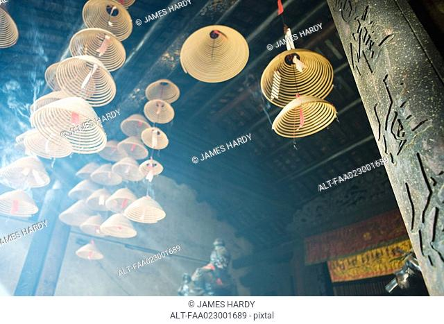Incense burning in Chinese temple, low angle view