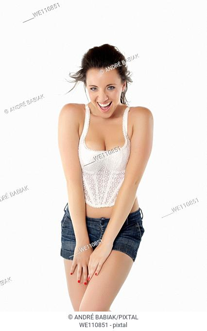 Attractive woman in jeans shorts and corset