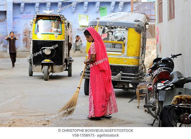 India, Rajasthan, Jodhpur, Harijan woman sweeping the streets